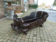 Barock style A sleigh transformed to a pair flower pots with dogs in carved wood, probably Germany 1770