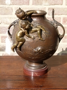 Belle epoque style bronze vase with putto,s on red marble base in patinated bronze, France 1890