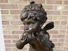 Belle epoque, style Sculpture of a putto in patinated bronze, France 1880,unsigned probaply Moreau