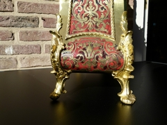 Louis 15 style Boulle cartel in turtelshel and gilded bronzes, France 1870