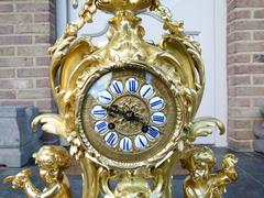Louis 15 style Clockset with putti,s Napoleon 3  in gilded bronze, France 1880