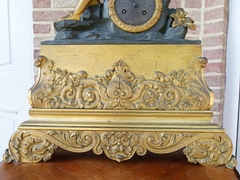 Louis Philippe style Clock pendule in gilded and patinated bronze , France 1860