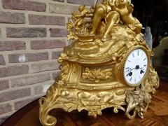 Louis Philippe style Gilded clock in bronze and spelter, France 1870