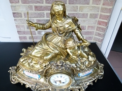 Napoleon III style huge Clock with a woman and child signed by Popon in gilt bronze and sévres porcelain, France 1880