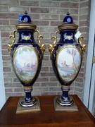 Napoleon III style Pair Sévres vases with romantic scenes by Jules Tiélés à Paris in faience, France 1880