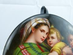 style painting on porcelain plate of a mother with child in porcelain 1880