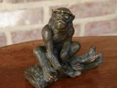 Signed with a V.1902 style Miniature bronze sculpture of a monkey in patinated bronze 1900